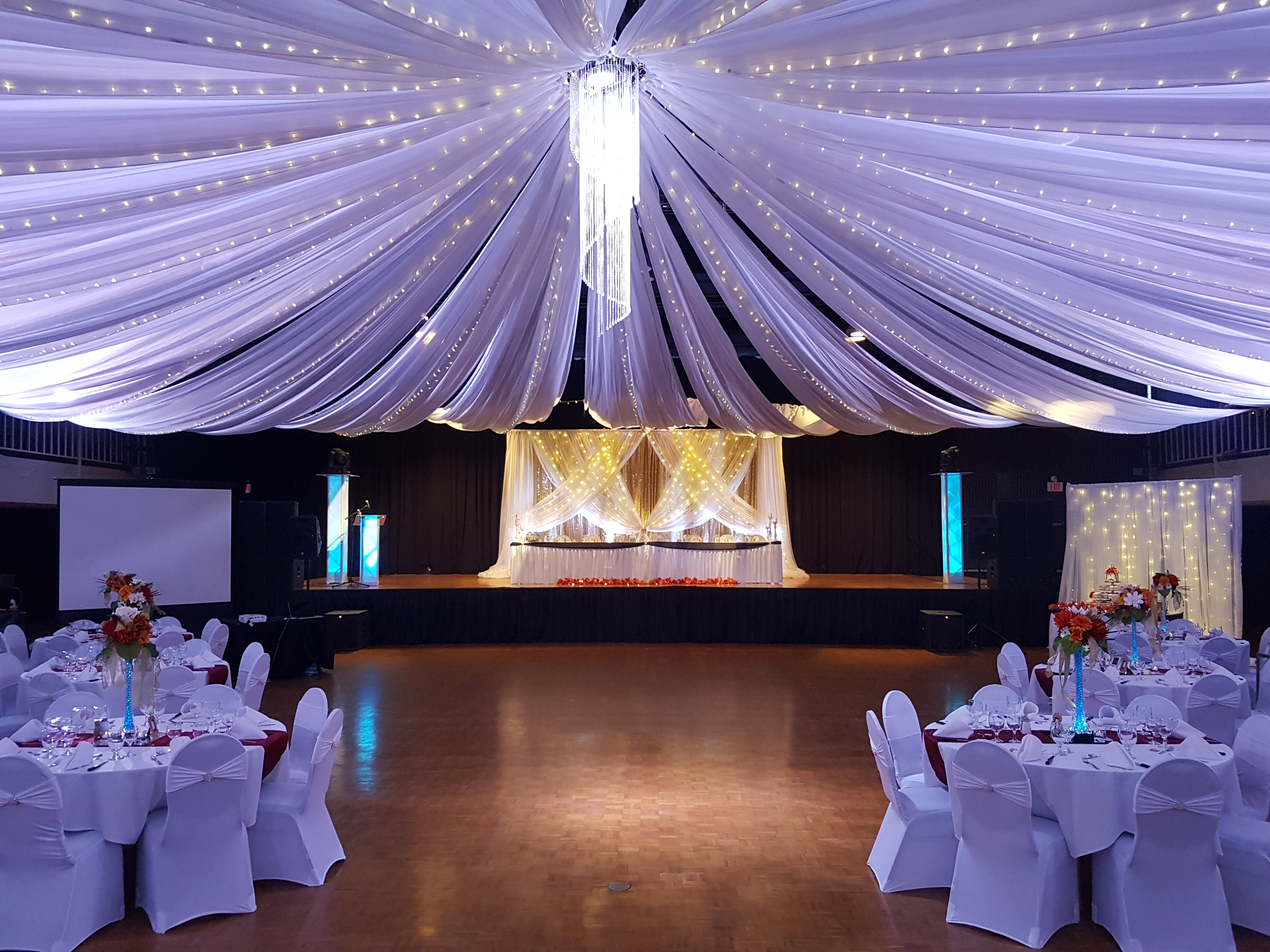 Beautiful Turvey Center up lit in blue for a wedding