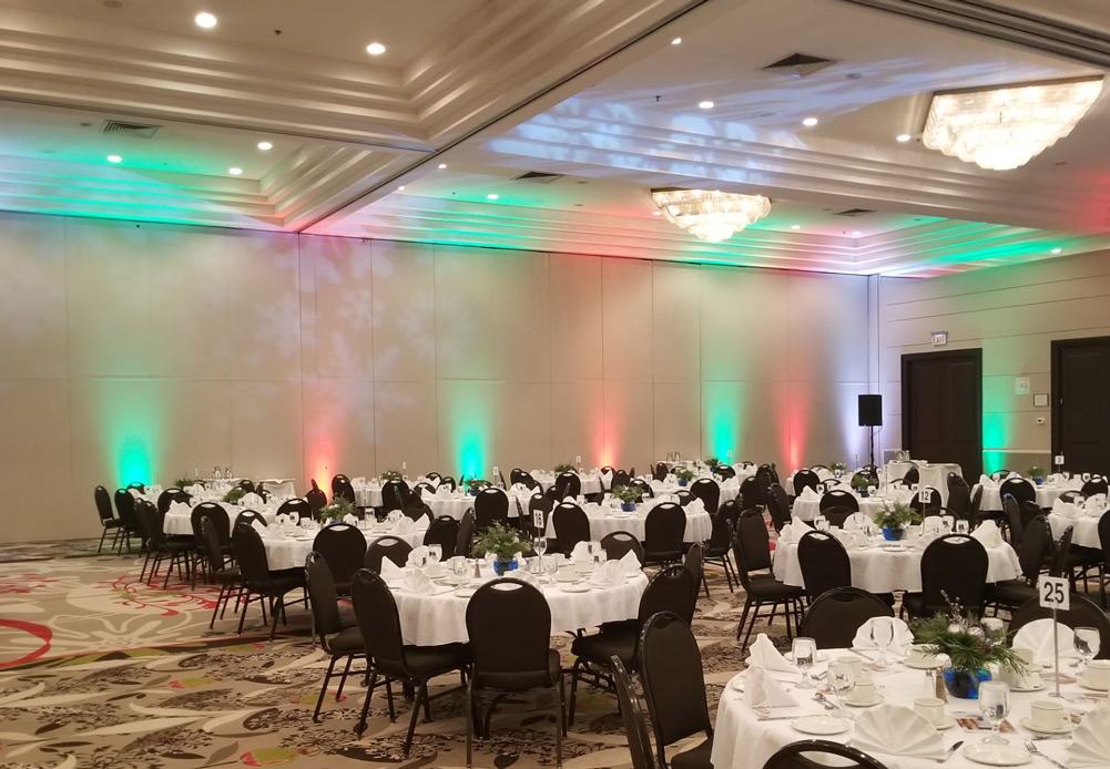 Red and green uplighting for a corporate Christmas party in Regina